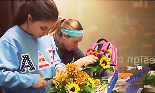floral design students arranging flowers